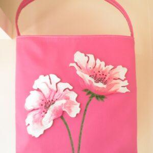 Bolso shopper rosa con flores blancas